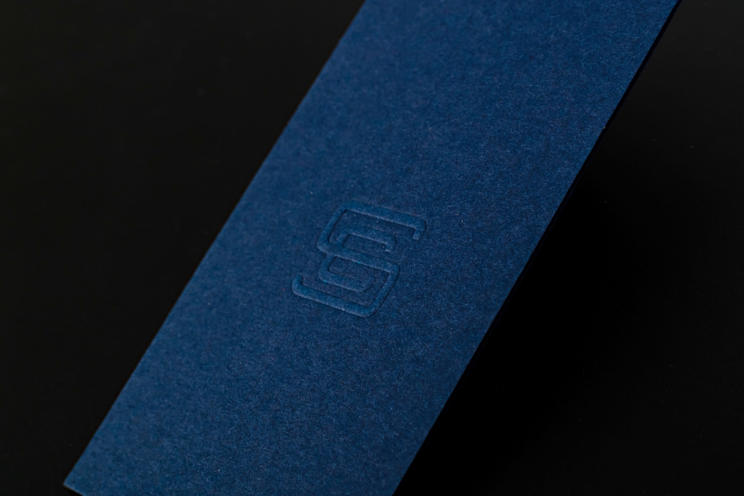 blind embossed business card on gmund blue matt paper